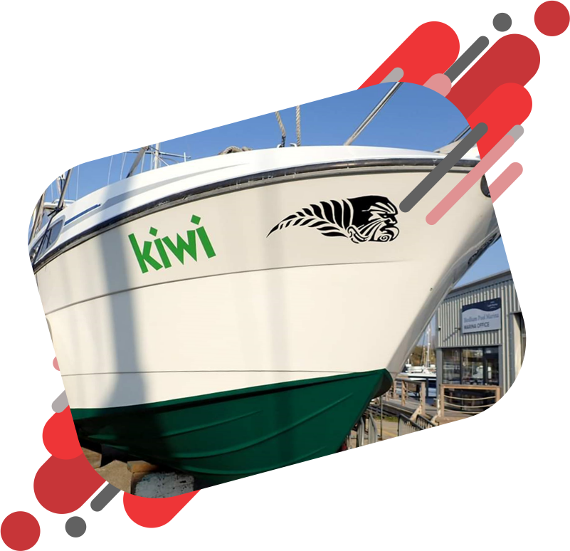 Kiwi logo boat decal applied to the side of a big white boat