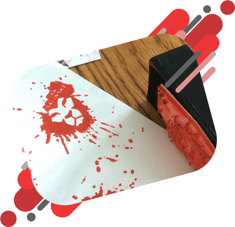 Red Rubber Stamp in the shape of a lion's head with ink spatters