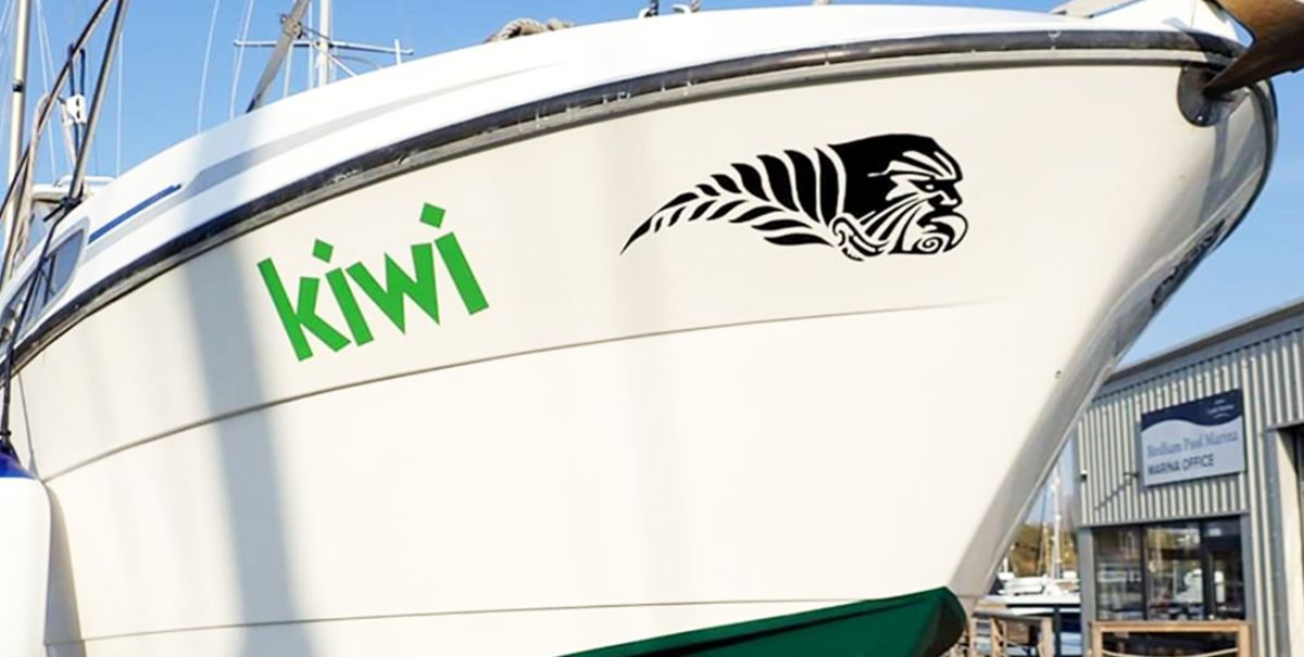 Green logo decal on a big white boat