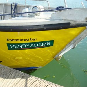sponsored by green decal on a yellow boat