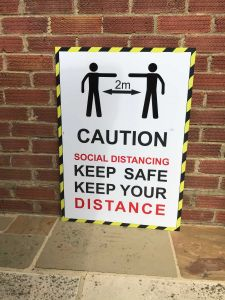 social distancing signs give reminder of covid restrictions