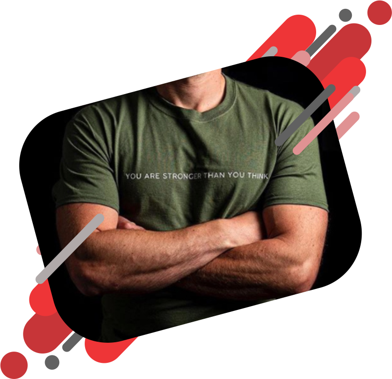 Strong man with crossed arms wearing a military Green T Shirt with a slogan across the chest reading stronger than you think